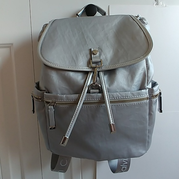 a8176b7cd2 Calvin Klein Bags | Silver Lobster Claw Flap Backpack | Poshmark